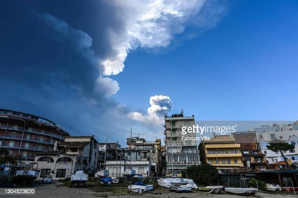 Mount Etna erupts with lava flowing at 300 metres high with a subsequent rain of volcanic ash falling on nearby villages is seen from the town of...