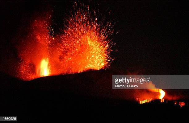 Mount Etna Europe's most active volcano explodes spilling lava down the mountain sides and shooting of ash into the sky November 26 2002 in Nicolosi...