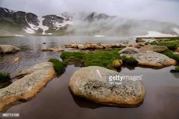 mount evans and summit lake with rocks in mist, colorado, usa - front range mountain range stock pictures, royalty-free photos & images