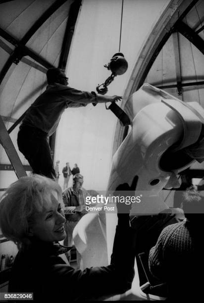 Mount Evans Workmen place 1400 pound Declination axle on Telescope Mount As DrJanet Roundtree Lesh Happily Looks on Credit Denver Post