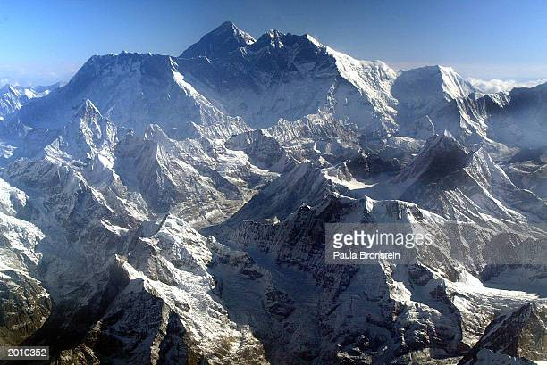 Mount Everest is shown at approximately 8850meter May 18 2003 in Nepal The world's tallest mountain is surrounded by Nuptse 8848m and Lhotse 8576m A...