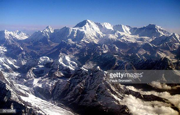 Mount Everest is shown at approximately 8,850-meter May 18, 2003 in Nepal. The world's tallest mountain is surrounded by Nuptse 8848m and Lhotse,...