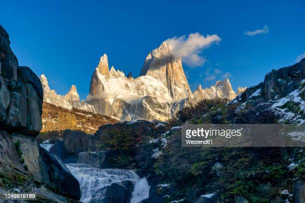 mount fitz roy and waterfall at sunrise in autumn, el chalten, patagonia, argentina - argentina stock pictures, royalty-free photos & images