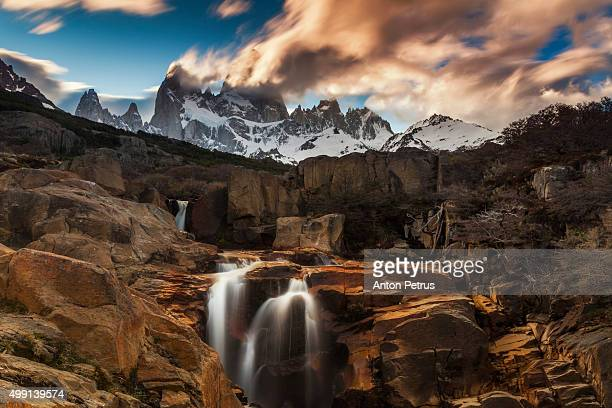 Mount Fitz Roy at sunset with waterfall