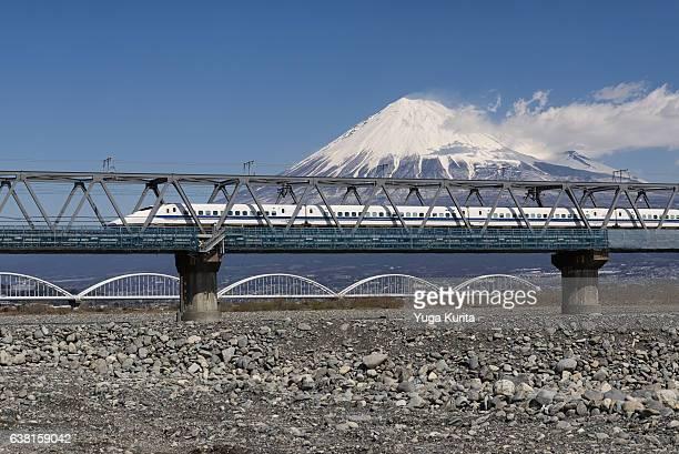 Mount Fuji and a Shinkansen Bullet Train Crossing Fujigawa River