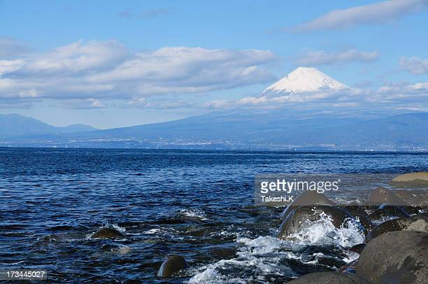 mount fuji and blue sea - mishima city stock photos and pictures