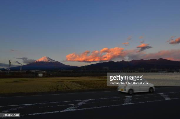 Mount Fuji and car passing by