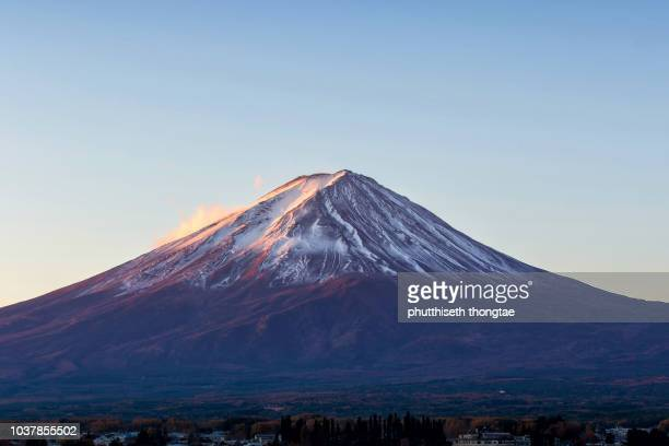 mount fuji at beautiful sunrise at lake kawaguchi in japan,fujisan located on honshu island,mount fuji is the highest mountain in japan.mount fuji is the unesco world heritage - volcanic terrain stock photos and pictures