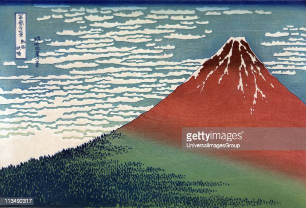 Mount Fuji in a Clear Dawn From 'Thirtysix Views of Mount Fuji' c1831 Katsushika Hokusai Japanese Ukiyoe artist Mountain rising from wooded slope to...