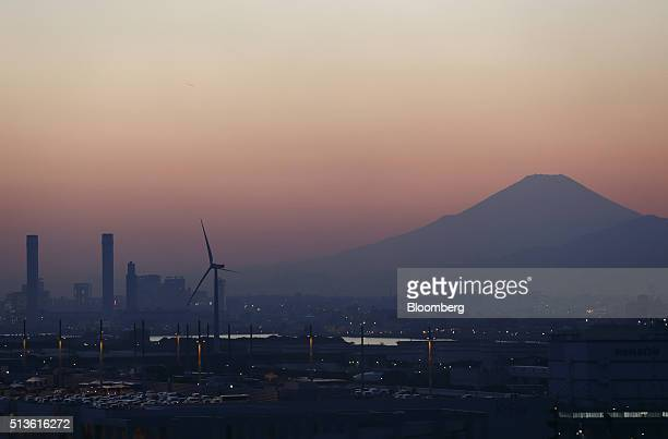 Mount Fuji is seen from an observatory in the Keihin Industrial Zone at dusk in Kawasaki Kanagawa Prefecture Japan on Thursday March 3 2016 The...
