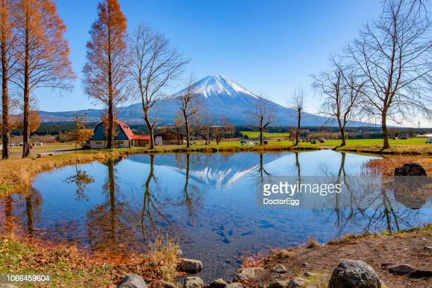 Mount Fuji Reflection in small pond at Fumotoppara Campground, Japan