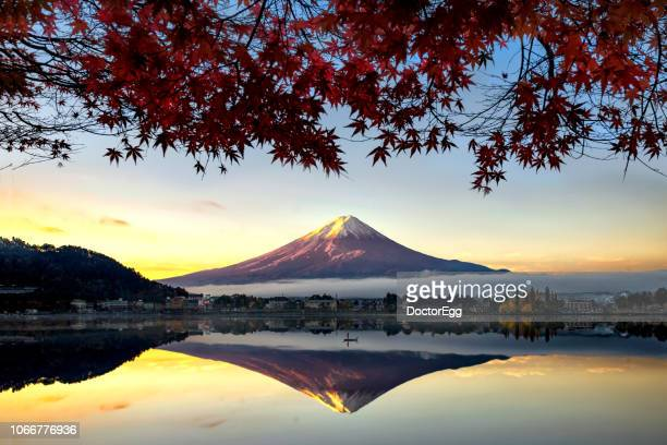 Mount Fuji Reflection with Morning Mist and Red Maple Leaves in Autumn at Kawaguchiko Lake, Japan