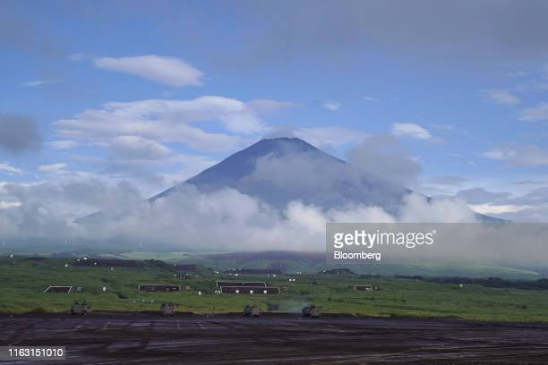 Mount Fuji stands beyond the Japan Ground Self-Defense Force vehicles prior to a live fire exercise in the Hataoka district of the East Fuji Maneuver...