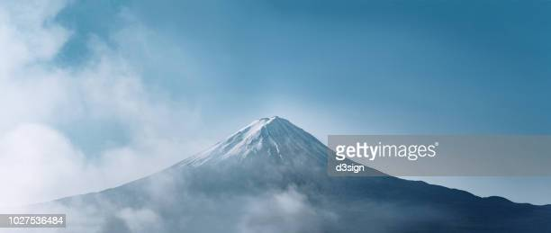 mount fuji with a refreshing appearance in the morning against clear blue sky - yamanashi prefecture stock pictures, royalty-free photos & images