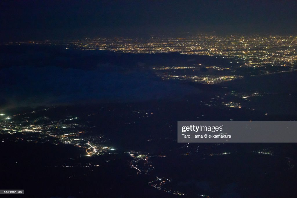 Mount Hakone, Suruga Bay, Mishima and Numazu cities in Shizuoka prefecture and Odawara and Hiratsuka cities in Kanagawa prefecture in Japan night time aerial view from airplane : Stock Photo