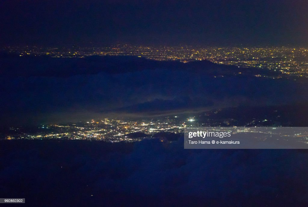 Mount Hakone, Suruga Bay, Mishima and Numazu cities in Shizuoka prefecture and Hiratsuka city in Kanagawa prefecture in Japan night time aerial view from airplane : ストックフォト