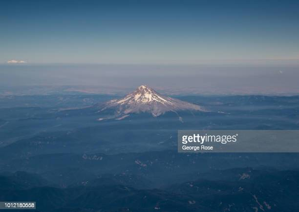 Mount Hood a dormat volcano located east of Portland is viewed from a southbound Alaska Airlines commercial flight on August 1 near Portland Oregon...