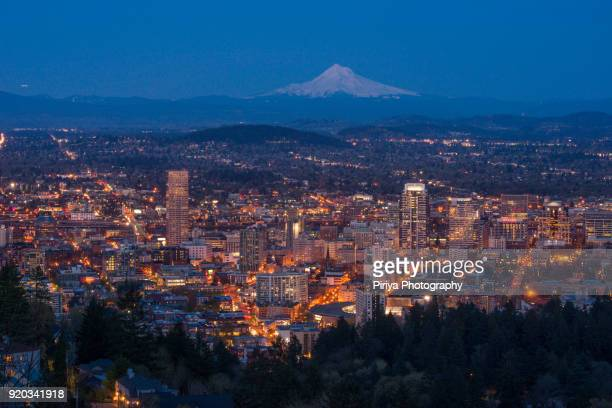 Mount Hood with downtown Portland at dusk from Pittock Mansion