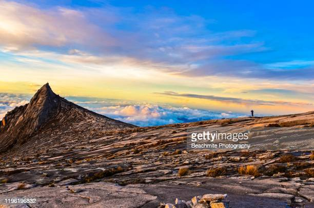 mount kinabalu's south peak at sunrise - kota kinabalu stock pictures, royalty-free photos & images