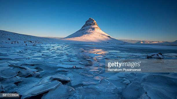 Mount kirkjufell and Kirkjufelfoss waterfall after a snowfall, Snaefellsnes peninsula, West Iceland
