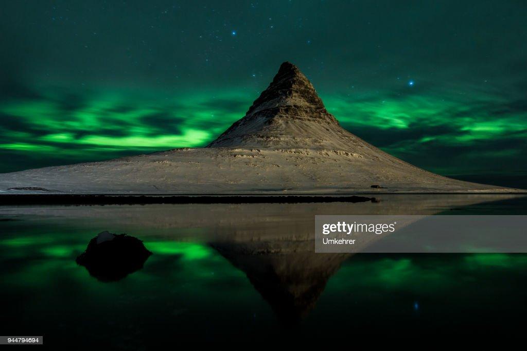 Mount kirkjufell in iceland with aurora borealis : Stock Photo