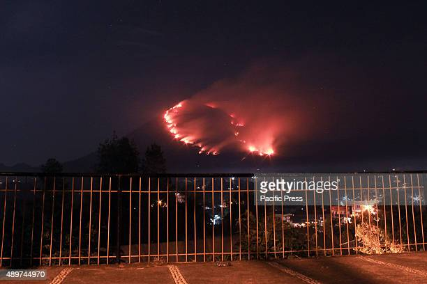 Mount Lokon on fire. The fire destroyed hundreds of hectares of forest area; and the fire is still lit and is heading nearer to the residential areas...