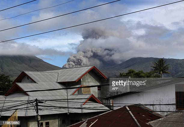 Mount Lokon spews ash 800 metres into the air near an abondoned village in Tomohon on July 16, 2011. More than 4,600 people have been evacuated since...