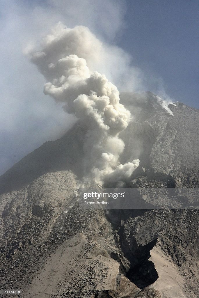 Mount Merapi is seen from Deles village, spewing smoke and ash June 11, 2006 on the outskirts of Yogyakarta, Central Java Province, Indonesia. Mount Merapi (Fire Mountain), has been increasing its volcanic activities since the May 27 earthquake that killed more than 5,700 people.