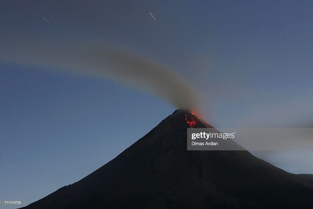 Mount Merapi is seen from Tunggul Arum village, spewing smoke and ash June 11, 2006 on the outskirts of Yogyakarta, Central Java Province, Indonesia. Mount Merapi (Fire Mountain), has been increasing its volcanic activities since the May 27 earthquake that killed more than 5,700 people.