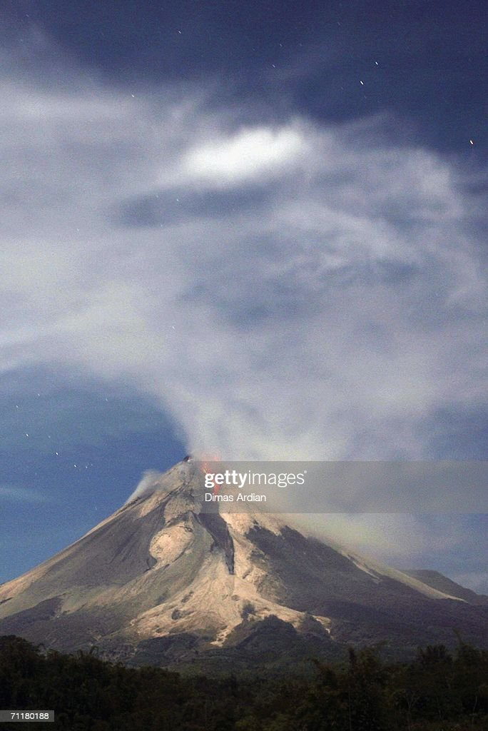Mount Merapi is seen from Tunggul Arum village, spewing smoke and ash June 12, 2006 on the outskirts of Yogyakarta, Central Java Province, Indonesia. Mount Merapi (Fire Mountain), has been increasing its volcanic activities since the May 27 earthquake that killed more than 5,700 people.