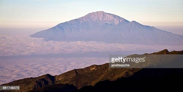 mount meru at sunrise seen from mount kilimanjaro, tanzania - mount meru stock photos and pictures