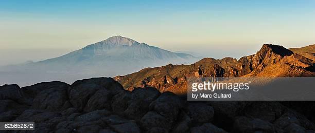 mount meru seen from mount kilimanjaro, tanzania - mount meru stock photos and pictures
