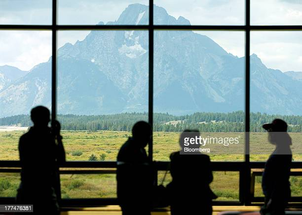 Mount Moran in Grand Teton National Park is seen through a window at the Jackson Hole economic symposium sponsored by the Kansas City Federal Reserve...