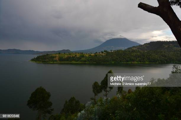 Mount Muhabura above the lush coasts of Lake Burera