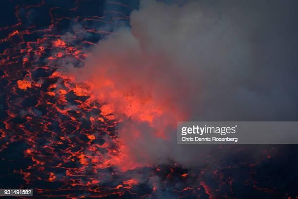 mount nyiragongo's lava lake. - smoking crack stock photos and pictures