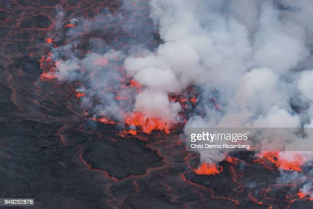 mount nyiragongo's lava lake. - smoking crack stock photos and pictures
