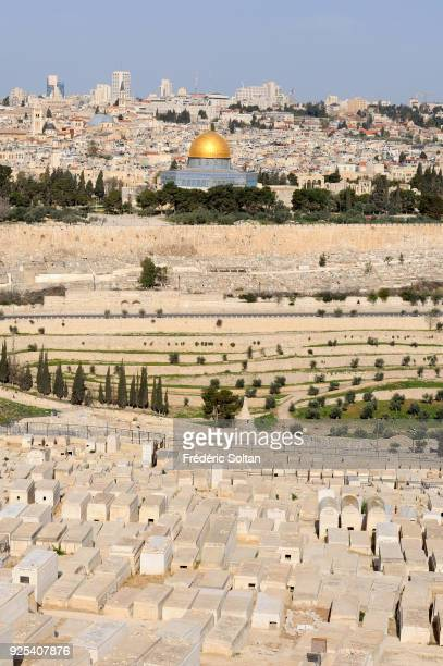 Mount of Olives Jewish cemetery in Jerusalem and view on the Dome of the Rock and the Old City of Jerusalem on May 20 2014 in Jerusalem Israel