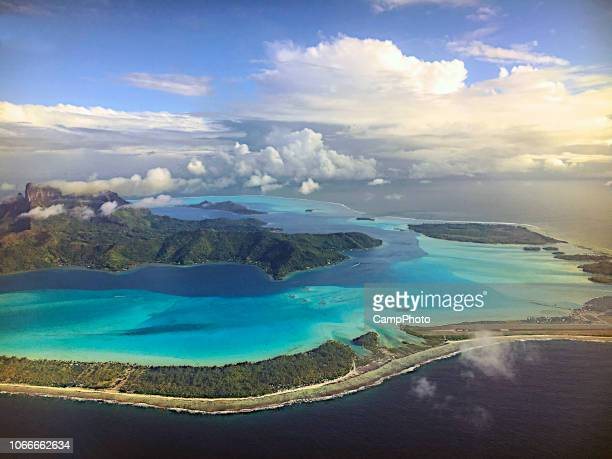 mount otemanu and bora bora aerial view - pacific ocean stock photos and pictures
