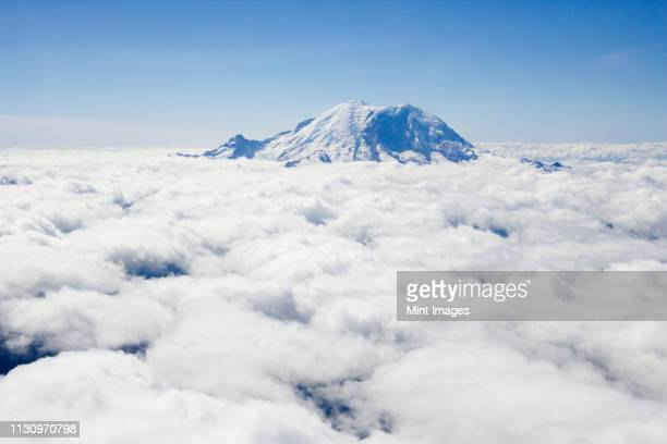 mount rainier above the clouds - cascade range stock pictures, royalty-free photos & images