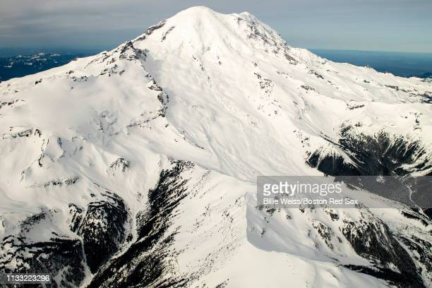 Mount Rainier is shown as Jackie Bradley Jr. #19 of the Boston Red Sox takes a charter flight over Mount Rainier in Seattle, Washington on March 27,...