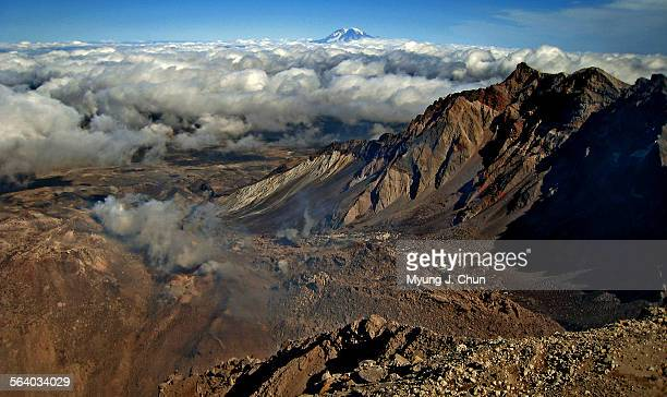 Mount Rainier is visible above the clouds in the distance in a view looking northwest from the crater of Mount St. Helens on Saturday, September 22,...
