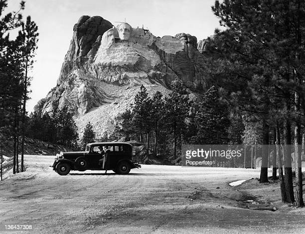 Mount Rushmore under construction with the face of President George Washington nearing completion in South Dakota USA circa 1930 In the foreground...