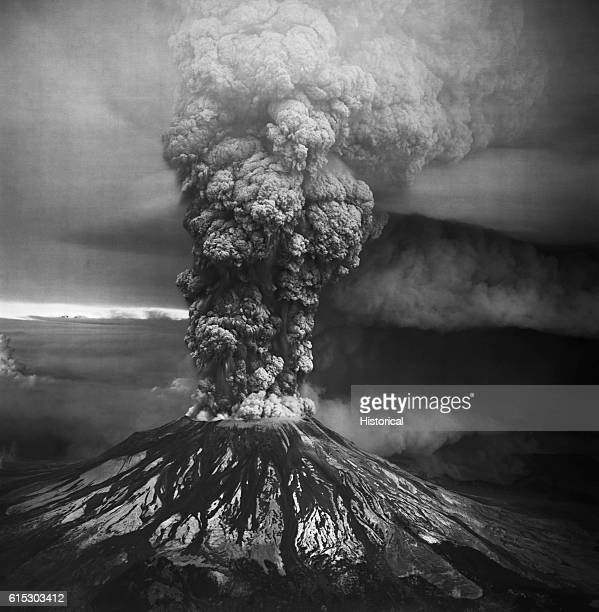 Mount Saint Helens in the southern Washington Cascades erupts violently on May 18 1980 This view from the south shows both aspects of the eruption...