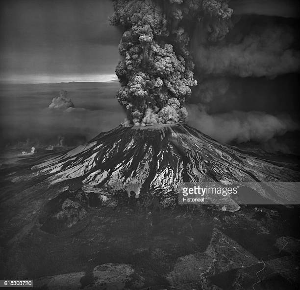 Mount Saint Helens in the southern Washington Cascades erupts violently on May 18, 1980. This view from the south shows both aspects of the eruption:...