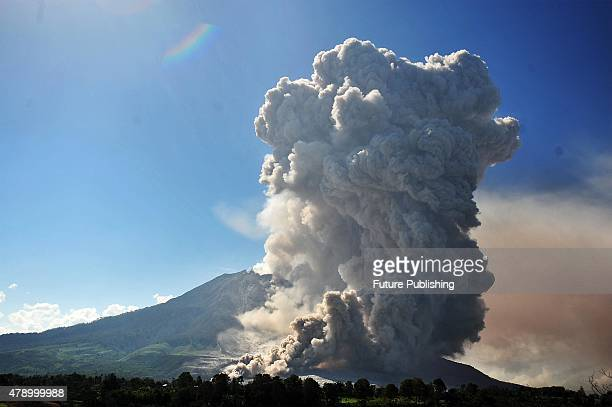 Mount Sinabung continues to erupt and spew gas and ash into the sky on June 29 2015 in Karo Indonesia Around 10000 people remain in temporary...