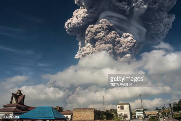 TOPSHOT Mount Sinabung erupts thick volcanic ash in Karo on Sumatra island on February 19 2018 An Indonesian volcano erupted February 19 sending a...