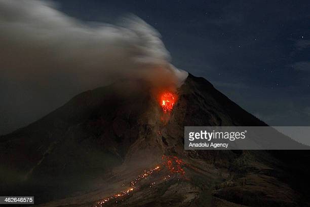 Mount Sinabung erupts with molten rocks and hot gasses as seen from Jeraya North Sumatra Indonesia early Tuesday Jan 14 2014