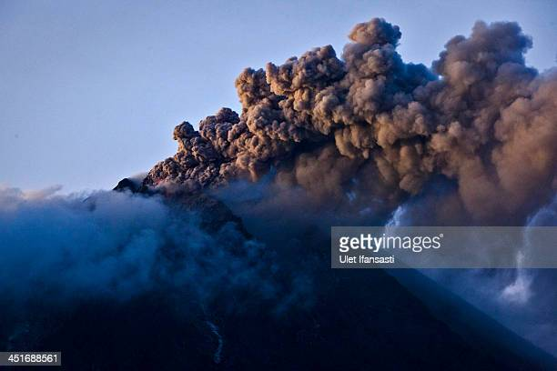 Mount Sinabung pyroclastic smoke seen from Berastepu village on November 24 2013 in Karo district North Sumatra Indonesia Mount Sinabung which has...