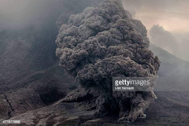 Mount Sinabung spews pyroclastic smoke seen from Tiga Kicat village on June 20 2015 in Karo District North Sumatra Indonesia According to The...