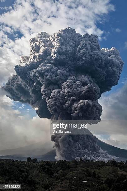 Mount Sinabung spews pyroclastic smoke seen from Tiga Pancur village on October 13 2014 in Berastagi Karo district North Sumatra Indonesia Mount...
